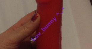 Red and black silicone dildo by Godemiche