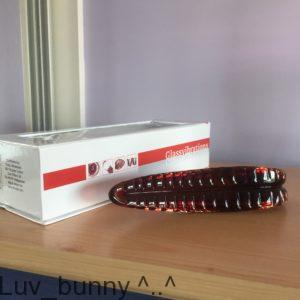 White flip-top box and red Glassvibrations Devils tongue textured dildo