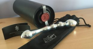 Crowned Jewels aluminium double ended dildo with black tube packaging and drawstring pouch.