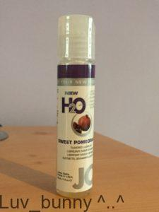 Small bottle of System Jo Sweet Pomegranate flavoured lubricant.