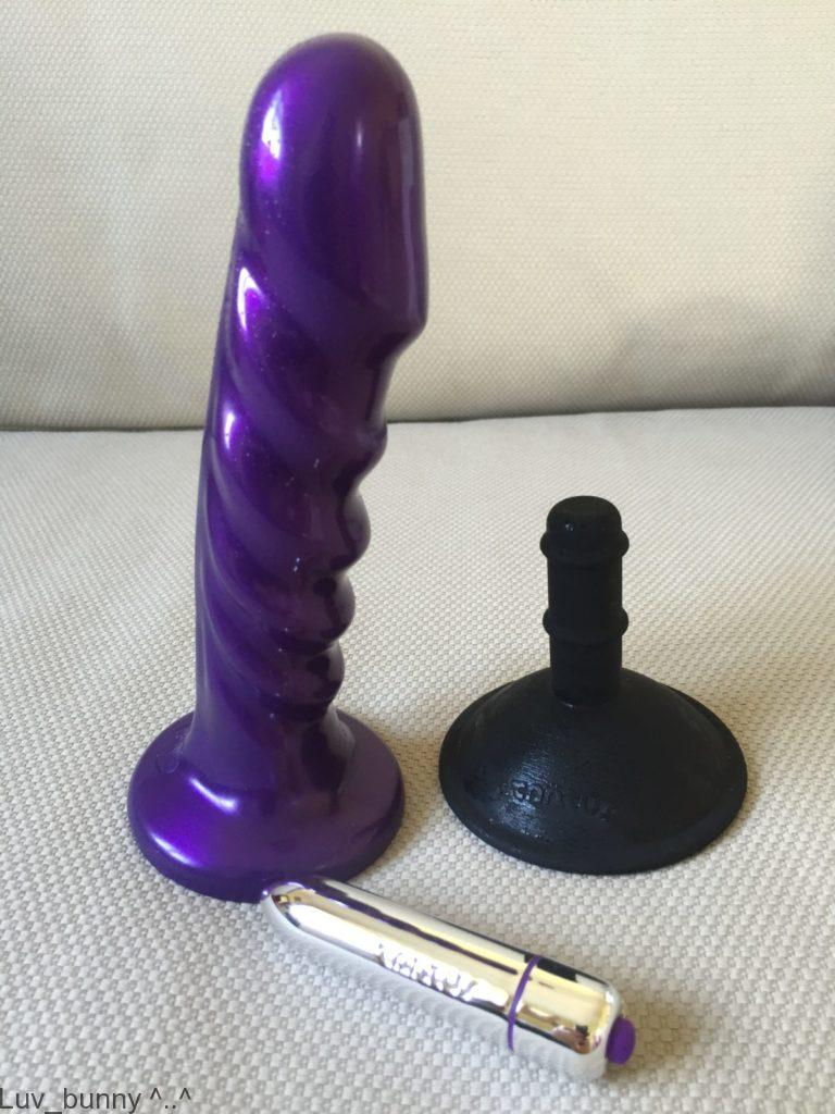 Purple silicone Tantus Echo dildo with black silicone suction cup and silver bullet vibrator