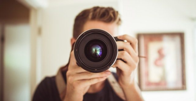 Photographer behind the camera