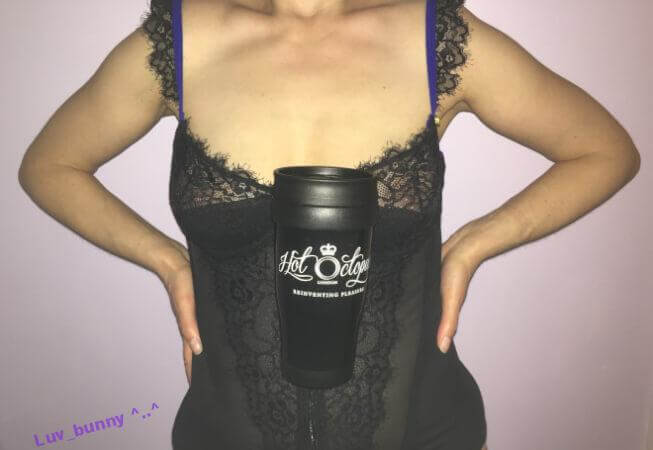 Luv Bunny wearing a black basque with a Hot Octopuss branded mug hooked into her cleavage