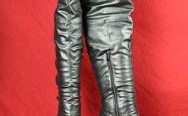Black Thigh high boots worn by Mistress