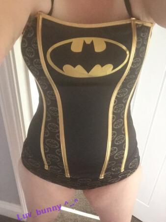 Luv Bunny wearing a black Batman corset