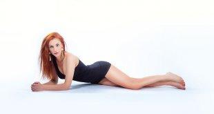 Redhead in tight black dress