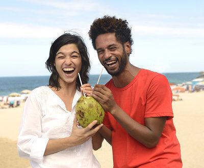 multi-ethnic female/male couple on the beach