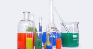 chemistry flasks with brightly coloured liquids