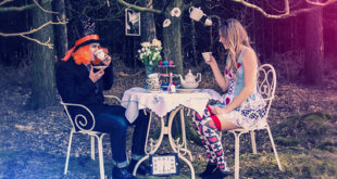 The Mad Hatter and Alice having a tea party