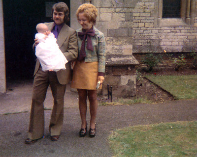 70s photo of a child and parents
