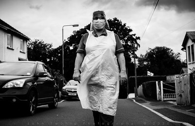 Black and white photo of a care worker in PPE