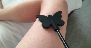 Luv Bunny's thigh with a black silicone butterfly crop