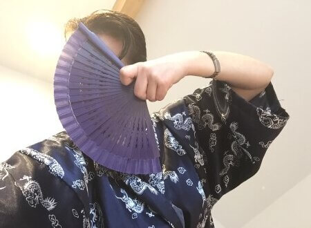 Luv Bunny wearing a blue silk dragon print Kimono with a spread out fan